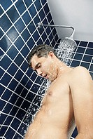 Close-up of a young man in the shower