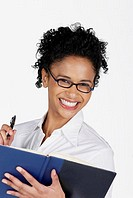 Portrait of a businesswoman holding a file with a pen