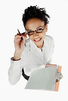 High angle view of a businesswoman holding a clipboard and smiling