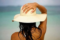 Rear view of a young woman wearing a sun hat