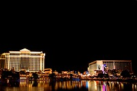 Buildings at the waterfront lit up at night, Las Vegas, Nevada, USA