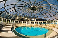 Modern look of a circular swimming pool in Somesta hotel, Bermuda