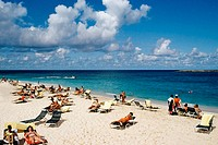 Large group of tourists sunbathing on a beach, Paradise Island, Bahamas