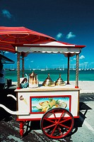 Side view of a cart with a brass lid and ice-cream cone placed on it, St. Martin