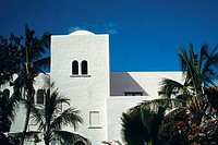 View of a white building amidst a foliage of palm trees, St. Maarten, Caribbean