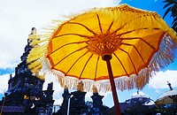Low angle view of a sunshade in front of a temple, Bali, Indonesia