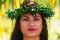 Portrait of a hula dancer wearing a headdress, Hawaii, USA