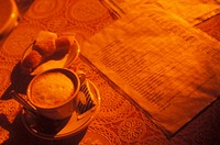 Close-up of a cup of tea with a menu on the table