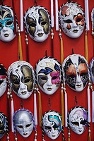 Close-up of masquerade masks hanging in a store, Venice, Veneto, Italy