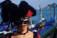 Portrait of a young woman wearing carnival mask, Venice, Veneto, Italy (thumbnail)