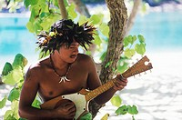 Close-up of a young man playing the ukulele, Hawaii, USA