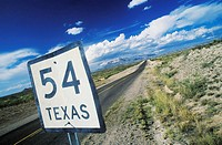 Close-up of a distance sign on the roadside, Texas, USA