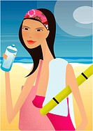 A woman drinking a bottle of water at the beach