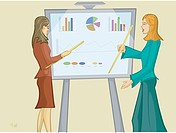 Women pointing at a sales chart