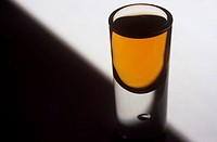 Close up of shot glass containing alcohol