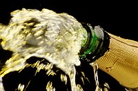 Close up of champagne being squirted from a bottle