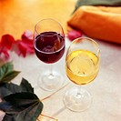 Red and white wine in wine glasses on a table