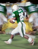USA, California, American football player (blurred motion)