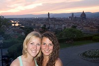 Italy, Tuscany, Florence, two young women smiling, portrait, sunset