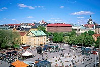 Aerial view of cafe spires and people in a square at Stockholm, Sweden