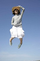 Young Asian woman jumping