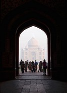 Tourist standing in front of a mausoleum, Taj Mahal, Agra, Uttar Pradesh, India