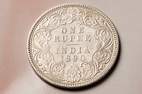 Close-up of an antique Indian one rupee coin