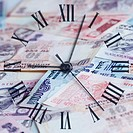 High angle view of a clock on Indian banknotes