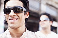 Close-up of a young man wearing sunglasses and smiling