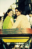 Rear view of a young couple sitting in a rickshaw