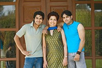 Portrait of a mature woman standing with her two sons