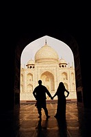 Silhouette of a couple standing in front of a mausoleum, Taj Mahal, Agra, Uttar Pradesh, India (thumbnail)
