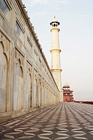 Low angle view of an ornate wall leading to a minaret, Taj Mahal, Agra, Uttar Pradesh, India