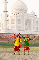 Two young men dancing in front of a mausoleum, Taj Mahal, Agra, Uttar Pradesh, India