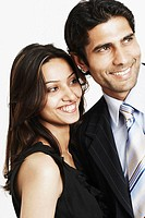 Close-up of a businessman and a businesswoman smiling (thumbnail)