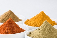 Close-up of four bowls of spices