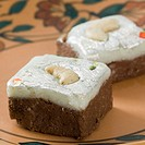 Close-up of chocolate Burfi garnished with Cashew nuts