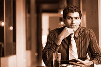 Portrait of a businessman sitting in a restaurant
