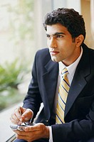 Close-up of a businessman using a personal data assistant (thumbnail)