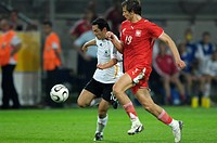 Sport, football, world championships, Germany versus Poland, 1:0, Dortmund, 14 6 2006, from left to right, Oliver Neuville, Bartosz Bosacki, footballe...