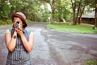Latino woman holding video camera