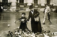 people, family, grandmother with grandchild, feeding doves, Odenosplatz, Munich, circa 1932, Germany, Bavaria, dove, historic, historical, child,