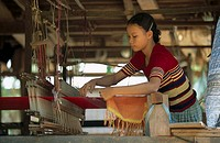 Young woman working on loom, Phnom Penh, Cambodia