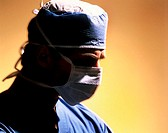 Close_up of male surgeon wearing surgical mask