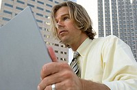Close-up of a businessman holding a laptop