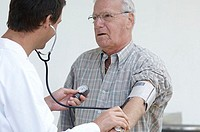 Close-up of a male doctor checking a senior man´s blood pressure