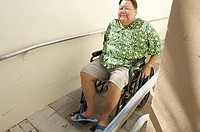 High angle view of a mature man sitting in a wheelchair