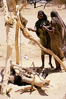 people, poverty, Sudan, women, standing at well, Africa, drought, aridity, aridness, desert, water deficiency, shortage, ethnology, ethnic, geography,