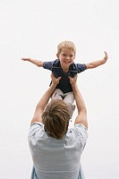Father and son playing airplane