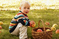 Child with red apples